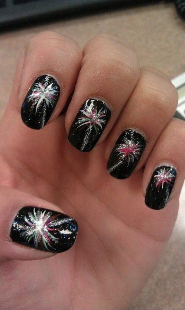 Photo of black nails with silver and pink fireworks