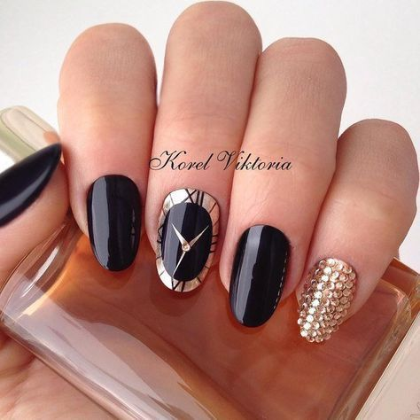 Photo of black nails with clock accent and gems