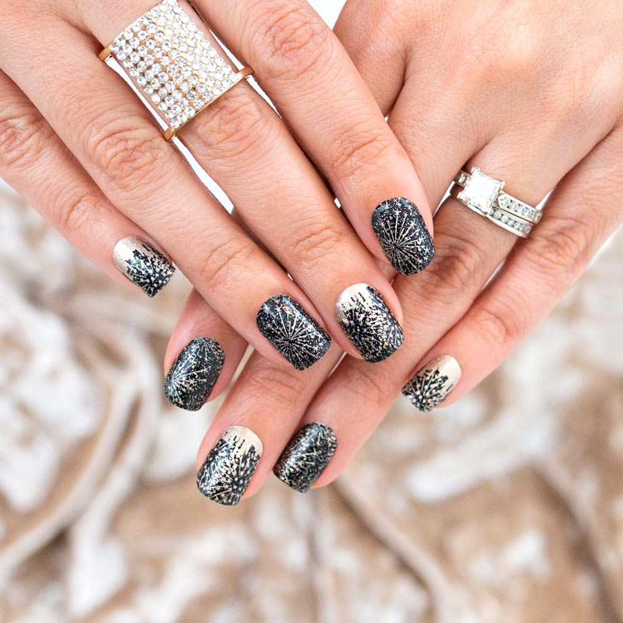 Photo of black nails with silver fireworks by Color Street