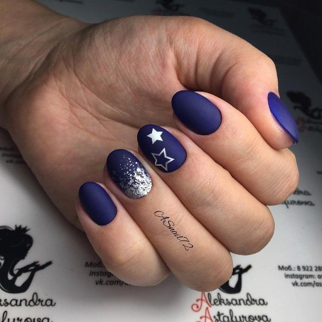 Photo of blue matte nails with stars and silver glitter