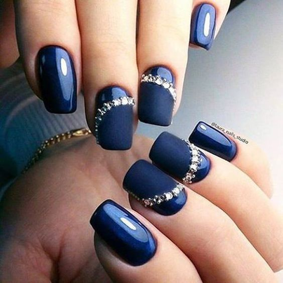 Photo of Glossy and Matte blue nails with gems