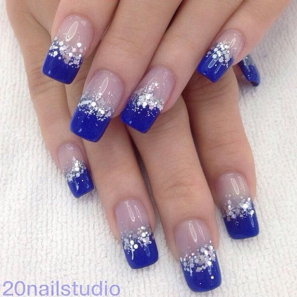 Photo of blue french tip nails with silver gltiter