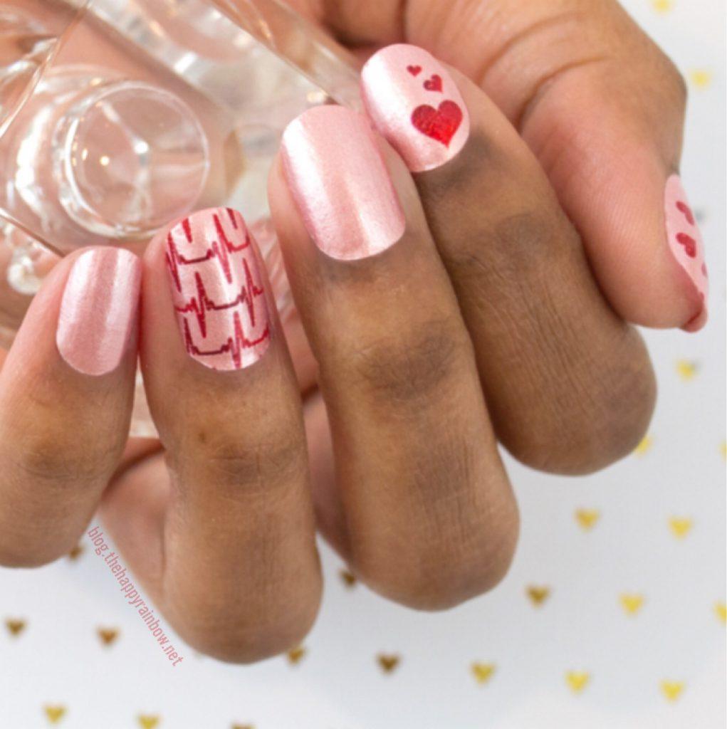 Photo of Helping Hands Heart Disease Awareness on dark hands
