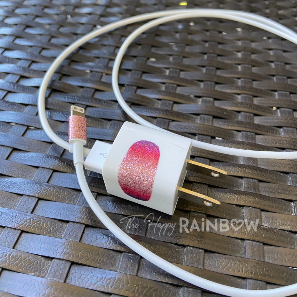 Image of iPhone charger with old nail polish strips on them